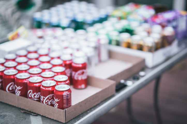 selective focus photography of red coca cola can lot on box